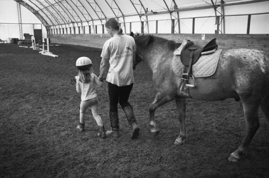 Girl walking a pony