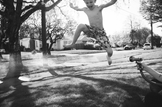 Jumping over hose.