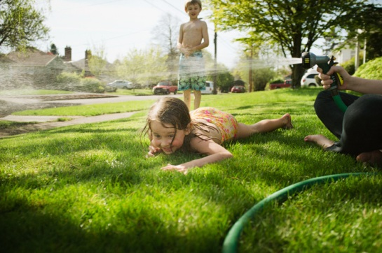Playing with hose in summer.