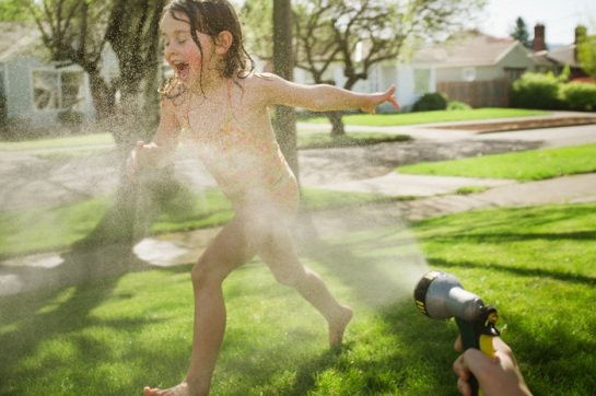 Playing in water hose.