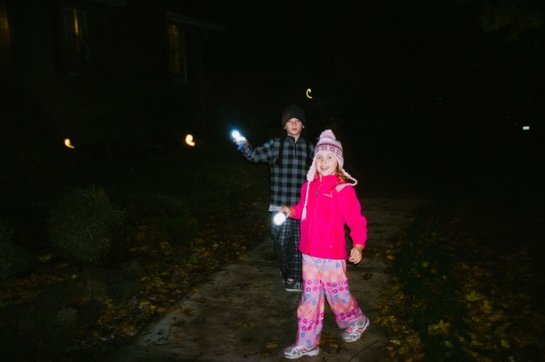 girl with flashlight in PJs