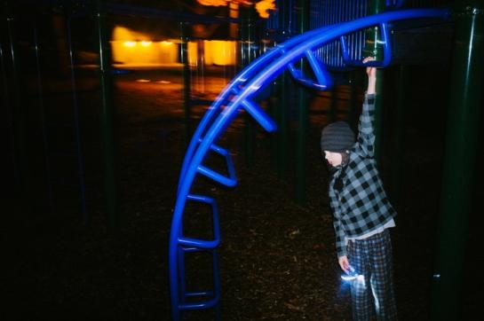 Boy playground night