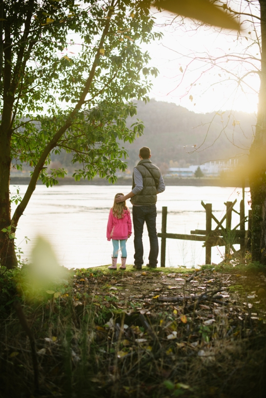 daughter and father looking out over river