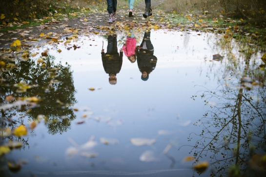 reflection of family in puddle