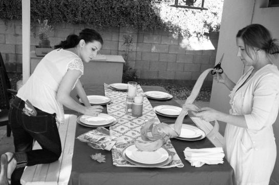 Sisters decorating table for thanksgiving