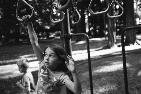 girl on monkey bars in portland park oregon