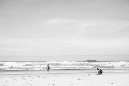 hug point oregon coast with kids playing on the beach