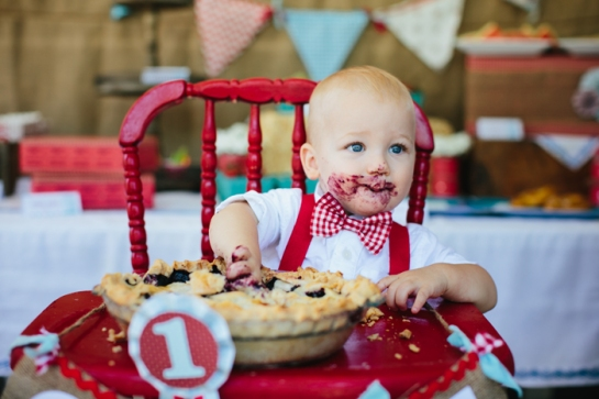 baby with pie face